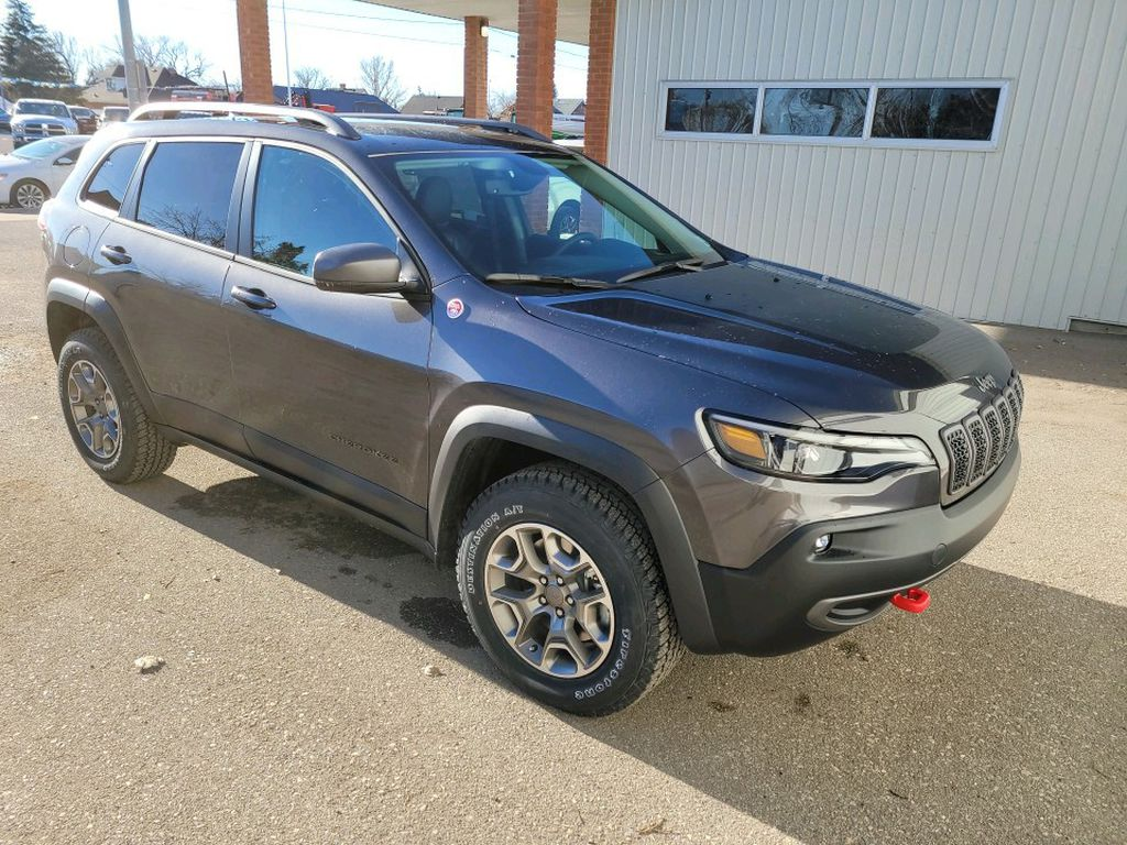 Grey 2021 Jeep Cherokee Left Front Rim and Tire Photo in Fort Macleod AB
