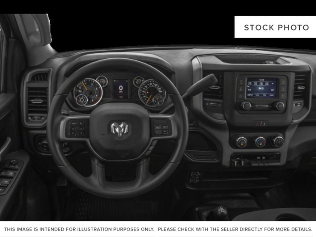 Red[Flame Red] 2021 Ram 2500 Steering Wheel and Dash Photo in Fort Macleod AB