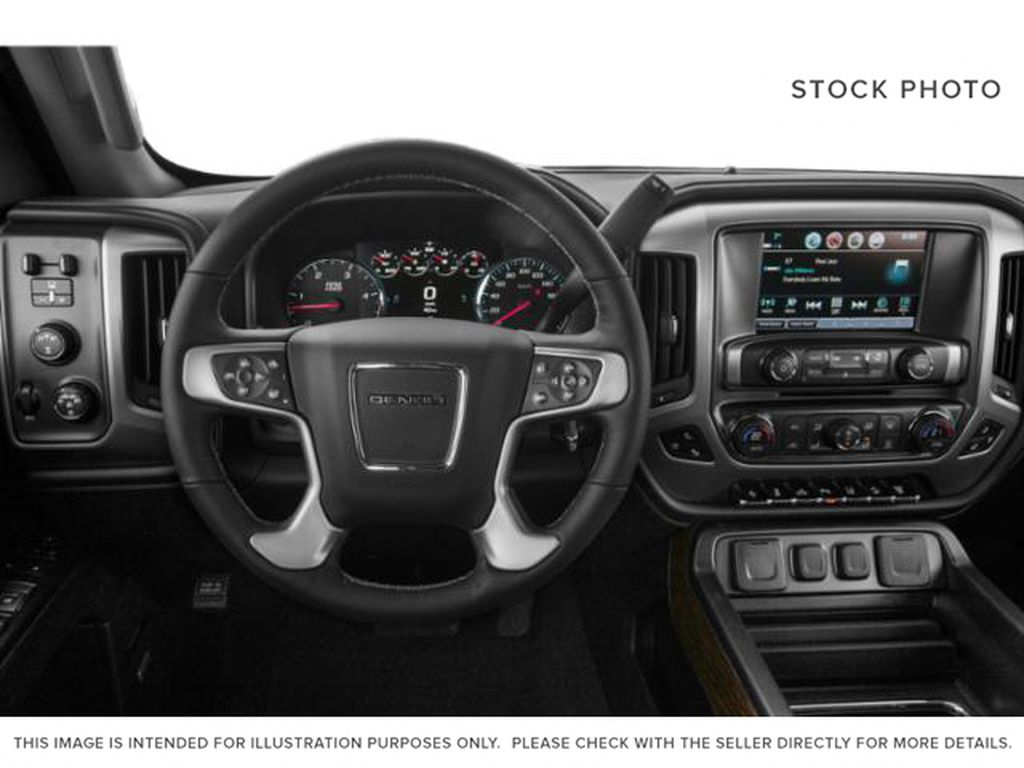 Silver[Quicksilver Metallic] 2019 GMC Sierra 2500HD Steering Wheel and Dash Photo in Fort Macleod AB