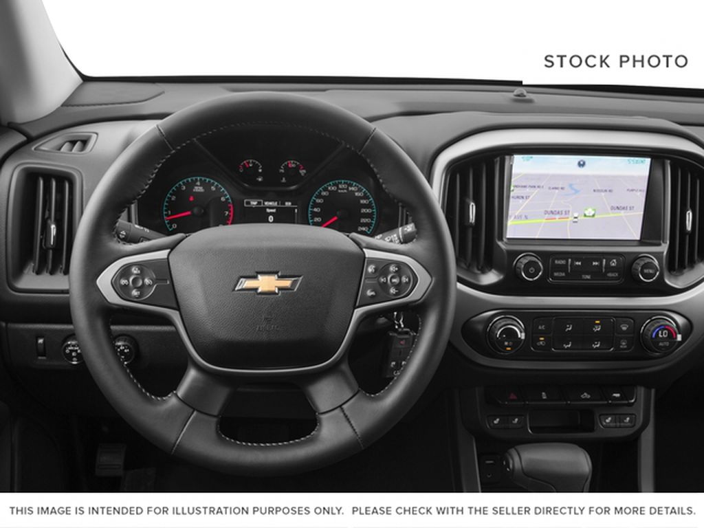 White[Summit White] 2016 Chevrolet Colorado Steering Wheel and Dash Photo in Fort Macleod AB