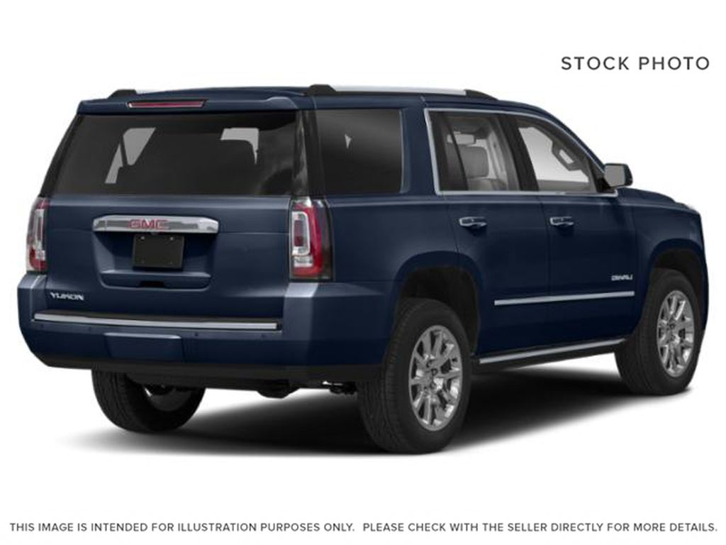 Blue[Dark Sapphire Blue Metallic] 2019 GMC Yukon Right Rear Corner Photo in Fort Macleod AB