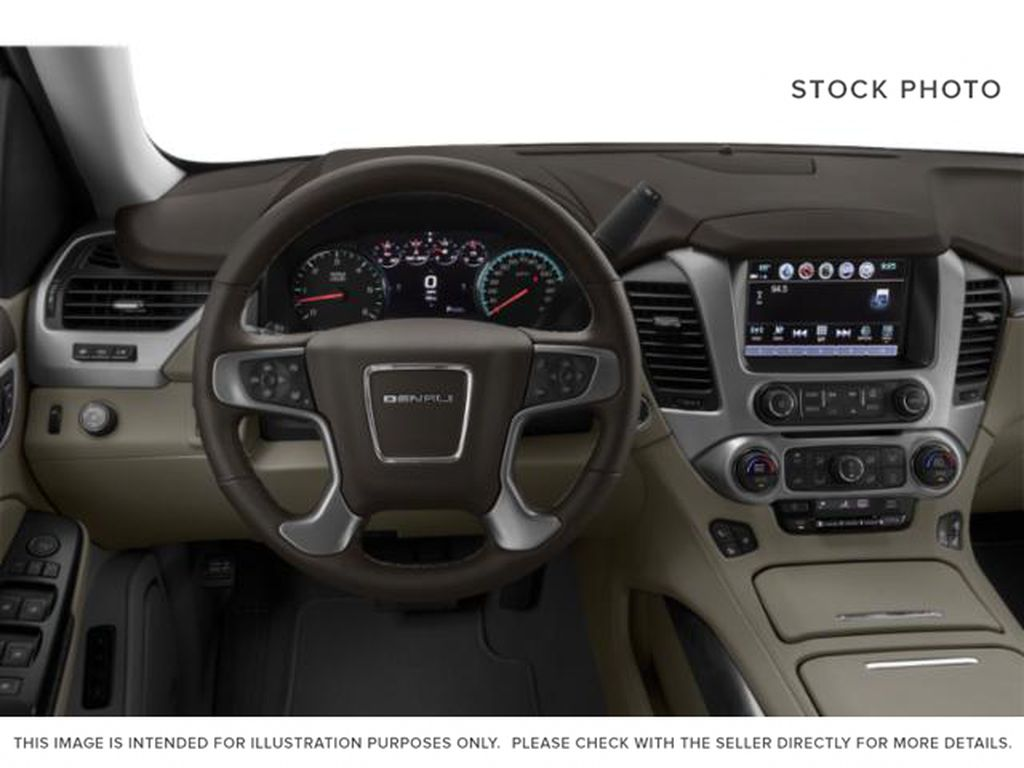 Blue[Dark Sapphire Blue Metallic] 2019 GMC Yukon Steering Wheel and Dash Photo in Fort Macleod AB
