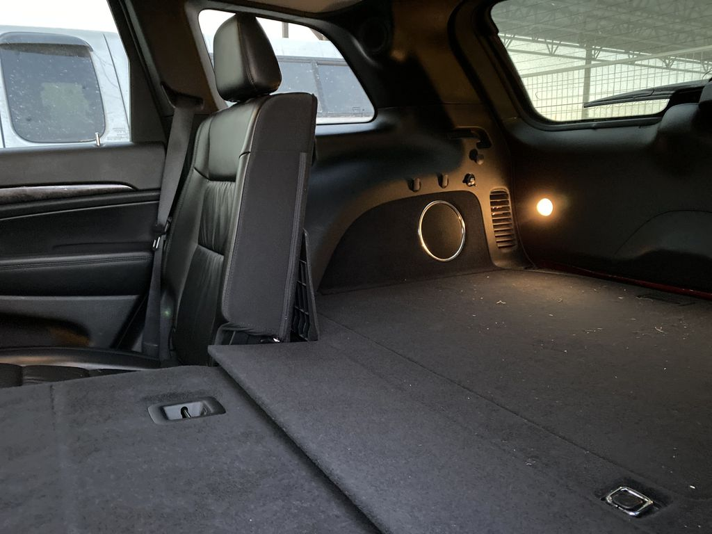 Red[Inferno Red Crystal Pearl] 2011 Jeep Grand Cherokee Rear Seat: Cargo/Storage Photo in Edmonton AB