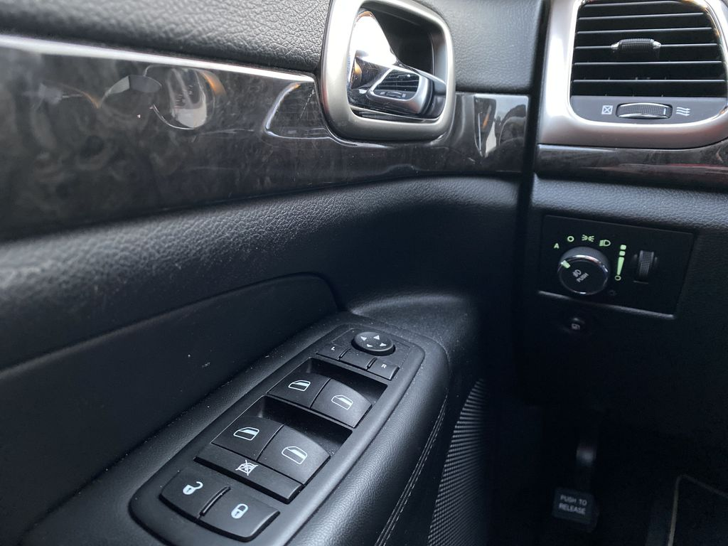 Red[Inferno Red Crystal Pearl] 2011 Jeep Grand Cherokee  Driver's Side Door Controls Photo in Edmonton AB