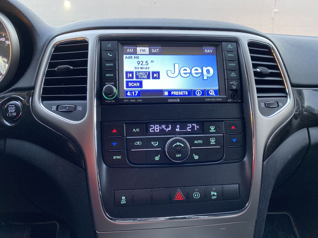 Red[Inferno Red Crystal Pearl] 2011 Jeep Grand Cherokee Central Dash Options Photo in Edmonton AB