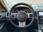 Red[Inferno Red Crystal Pearl] 2011 Jeep Grand Cherokee Steering Wheel and Dash Photo in Edmonton AB