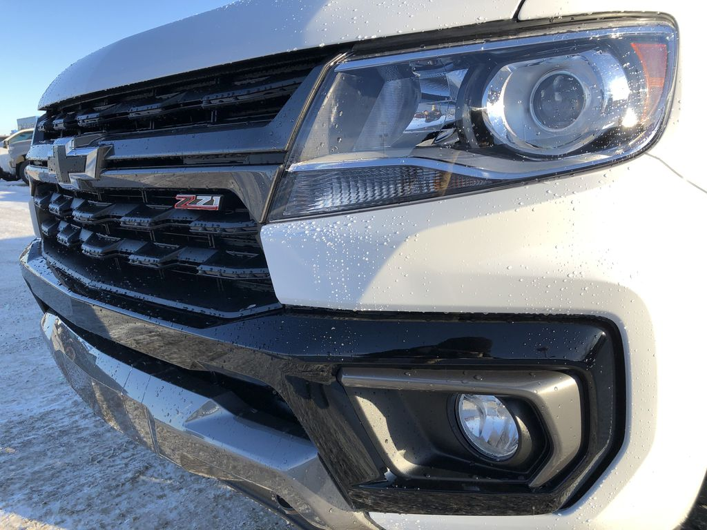 White[Summit White] 2021 Chevrolet Colorado Left Front Head Light / Bumper and Grill in Edmonton AB