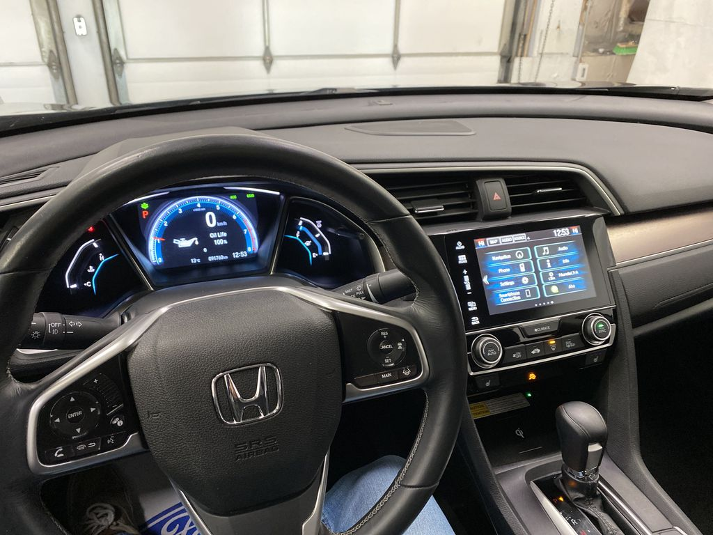 Gray[Modern Steel Metallic] 2016 Honda Civic Sedan Steering Wheel and Dash Photo in Dartmouth NS