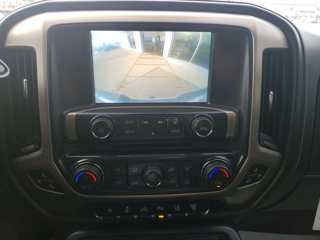 White 2018 GMC Sierra 3500HD Steering Wheel and Dash Photo in Westlock AB