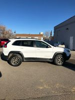 White 2020 Jeep Cherokee Left Front Rim and Tire Photo in Fort Macleod AB