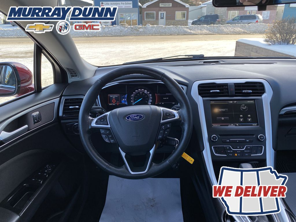 Red[Ruby Red Metallic Tinted Clearcoat] 2016 Ford Fusion Steering Wheel and Dash Photo in Nipawin SK