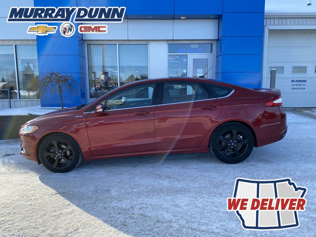 Red[Ruby Red Metallic Tinted Clearcoat] 2016 Ford Fusion Left Side Photo in Nipawin SK