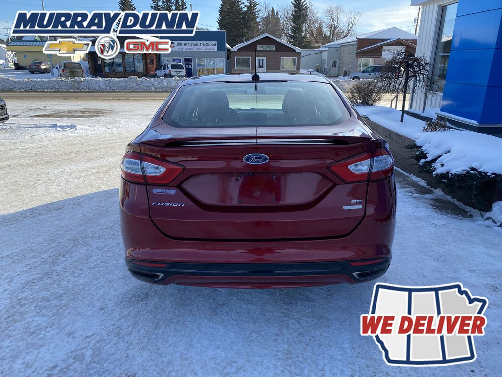 Red[Ruby Red Metallic Tinted Clearcoat] 2016 Ford Fusion Rear of Vehicle Photo in Nipawin SK