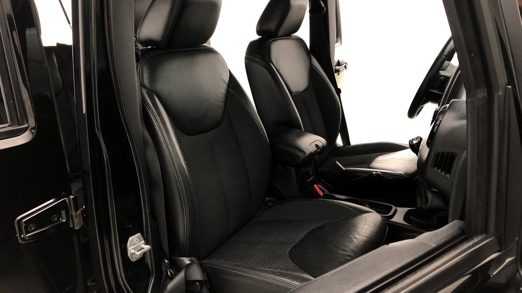 Black[Black] 2016 Jeep Wrangler Unlimited Back Country - Manual, Leather, NAV Right Side Front Seat  Photo in Winnipeg MB