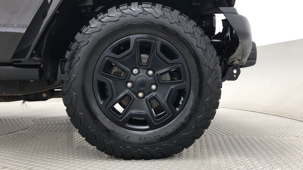 Black[Black] 2016 Jeep Wrangler Unlimited Back Country - Manual, Leather, NAV Right Front Rim and Tire Photo in Winnipeg MB