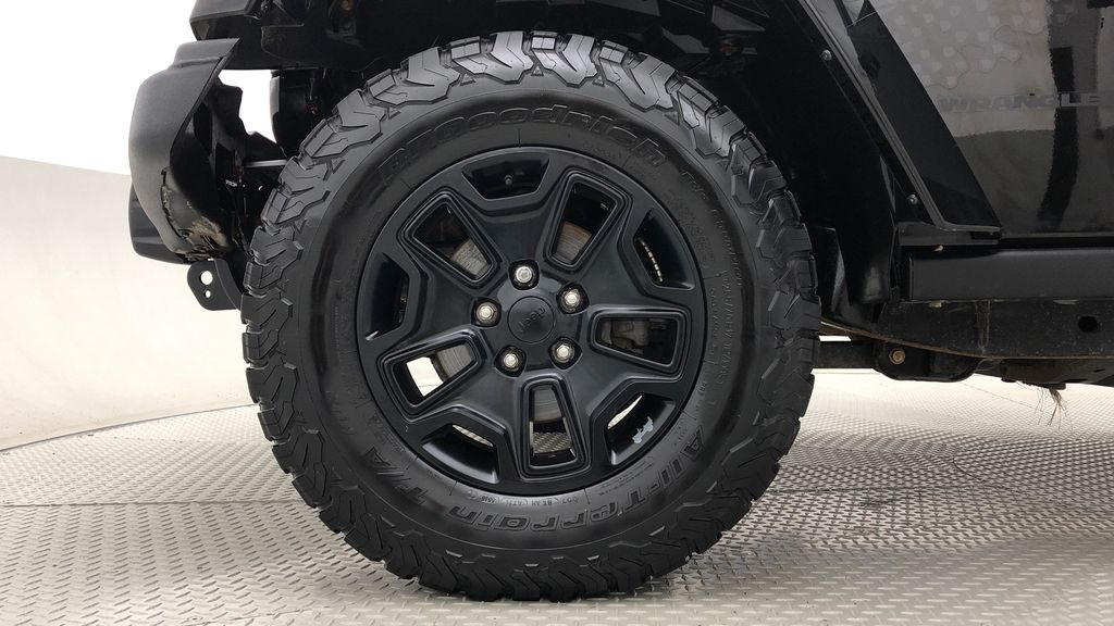 Black[Black] 2016 Jeep Wrangler Unlimited Back Country - Manual, Leather, NAV Left Front Rim and Tire Photo in Winnipeg MB