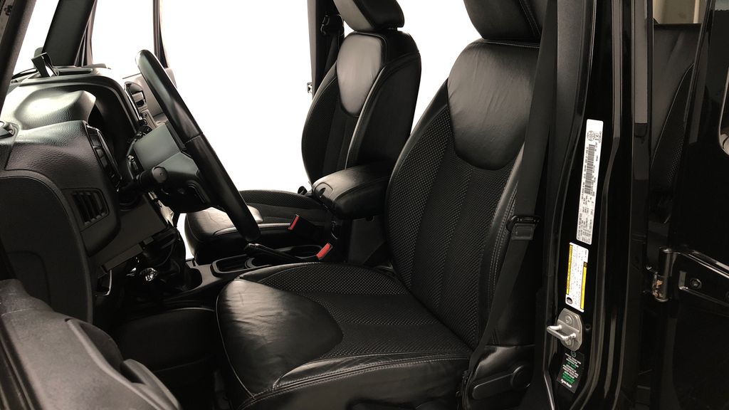 Black[Black] 2016 Jeep Wrangler Unlimited Back Country - Manual, Leather, NAV Left Front Interior Photo in Winnipeg MB