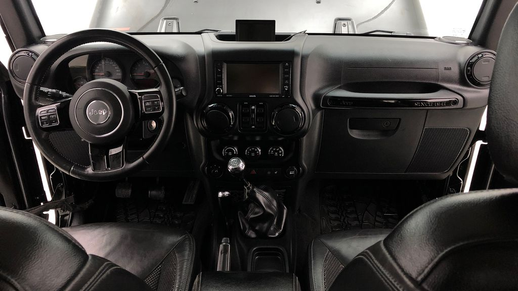 Black[Black] 2016 Jeep Wrangler Unlimited Back Country - Manual, Leather, NAV Central Dash Options Photo in Winnipeg MB