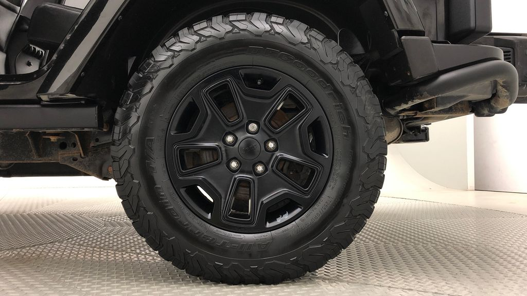 Black[Black] 2016 Jeep Wrangler Unlimited Back Country - Manual, Leather, NAV Left Rear Rim and Tire Photo in Winnipeg MB