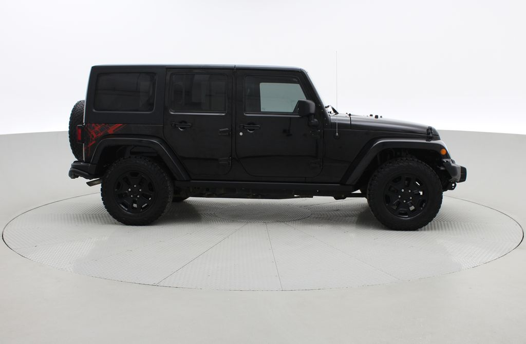 Black[Black] 2016 Jeep Wrangler Unlimited Back Country - Manual, Leather, NAV Right Side Photo in Winnipeg MB