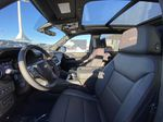 Black[Black] 2021 Chevrolet Tahoe High Country Left Front Interior Photo in Calgary AB