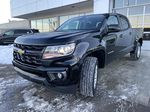 Black[Black] 2021 Chevrolet Colorado LT Left Front Head Light / Bumper and Grill in Calgary AB