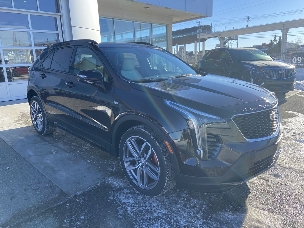 Red[Garnet Metallic] 2021 Cadillac XT4 Sport Right Front Corner Photo in Calgary AB