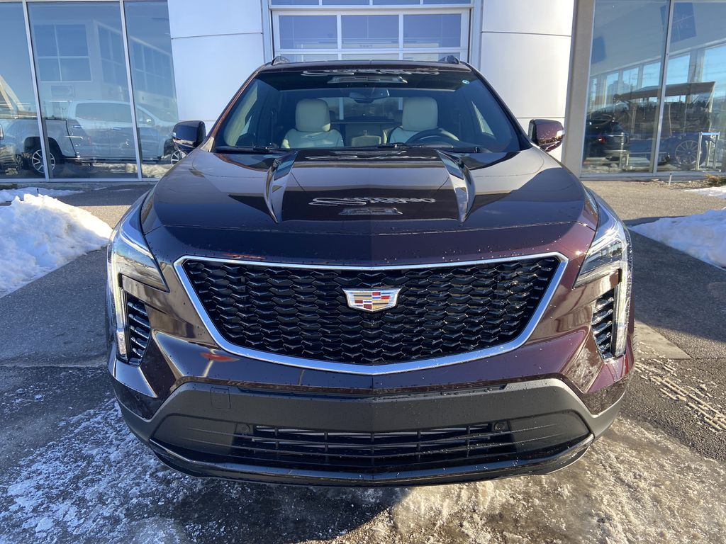 Red[Garnet Metallic] 2021 Cadillac XT4 Sport Front Vehicle Photo in Calgary AB