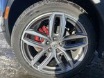 Red[Garnet Metallic] 2021 Cadillac XT4 Sport Left Front Rim and Tire Photo in Calgary AB