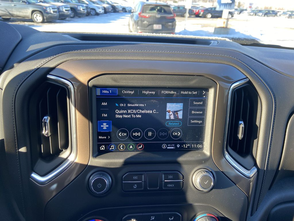 White[Iridescent Pearl Tricoat] 2021 Chevrolet Silverado 3500HD High Country Radio Controls Closeup Photo in Calgary AB