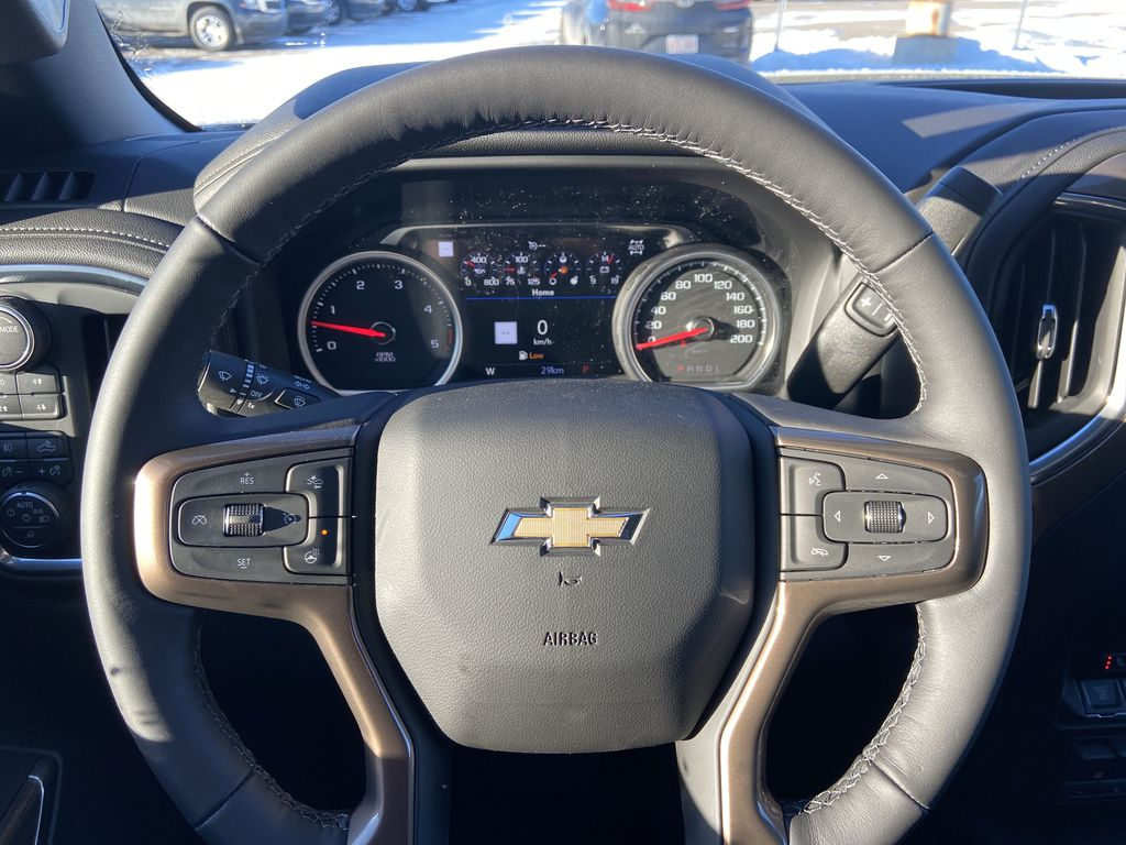 White[Iridescent Pearl Tricoat] 2021 Chevrolet Silverado 3500HD High Country Steering Wheel and Dash Photo in Calgary AB