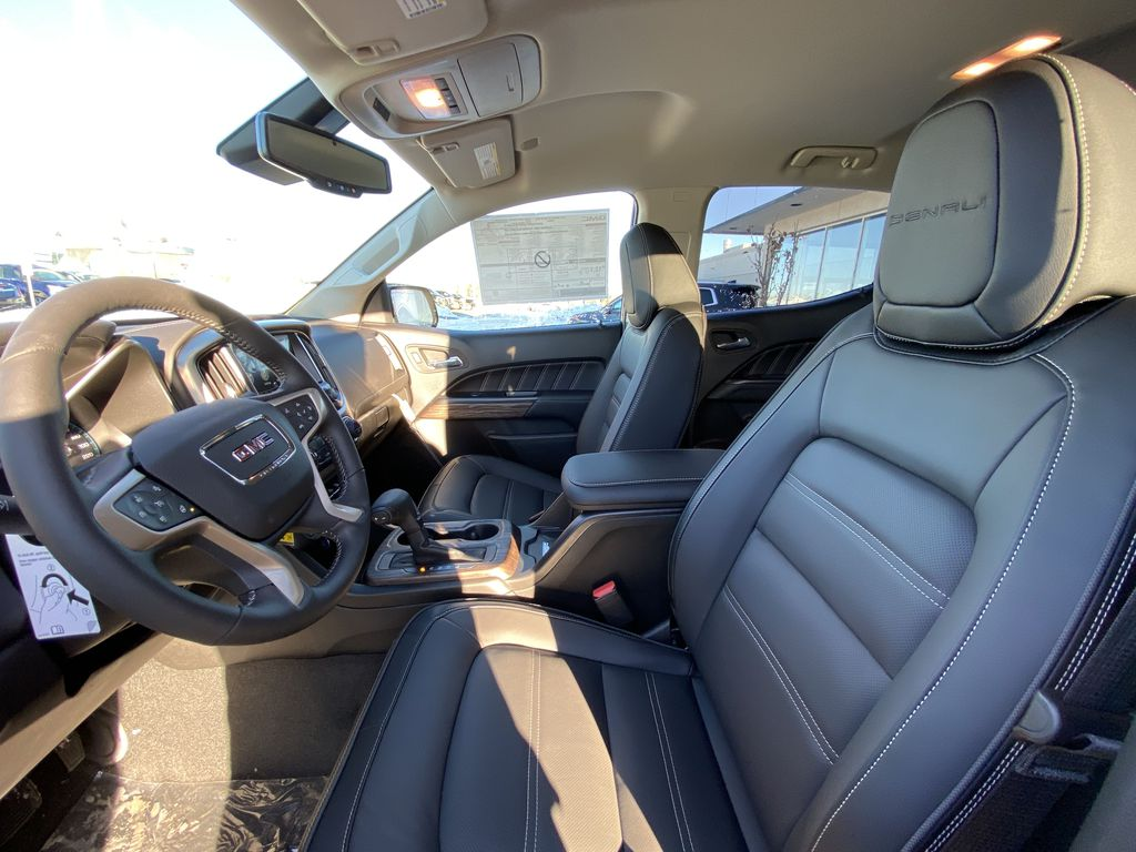 Red[Cayenne Red Tintcoat] 2021 GMC Canyon Denali Left Front Interior Photo in Calgary AB