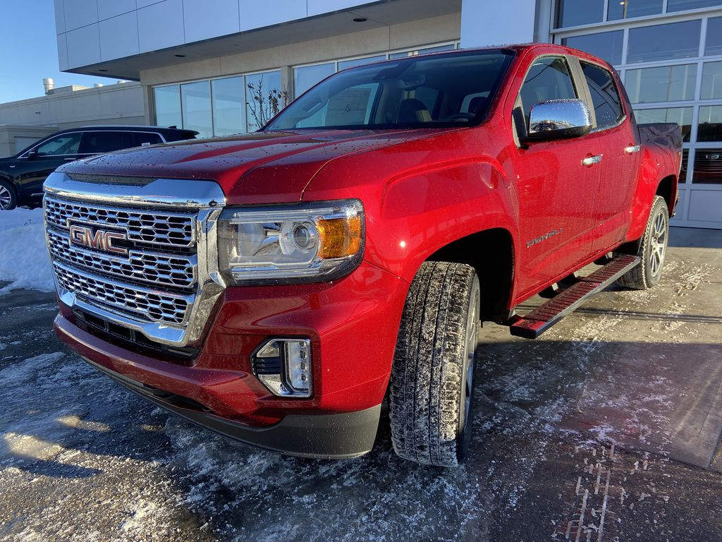 Red[Cayenne Red Tintcoat] 2021 GMC Canyon Denali Left Front Head Light / Bumper and Grill in Calgary AB