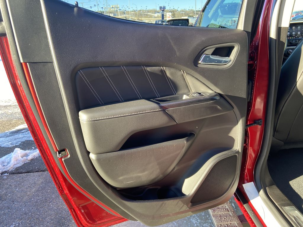 Red[Cayenne Red Tintcoat] 2021 GMC Canyon Denali Left Rear Interior Door Panel Photo in Calgary AB