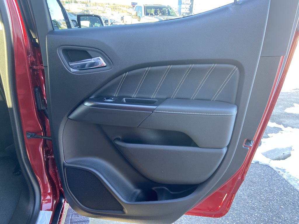 Red[Cayenne Red Tintcoat] 2021 GMC Canyon Denali Right Rear Interior Door Panel Photo in Calgary AB