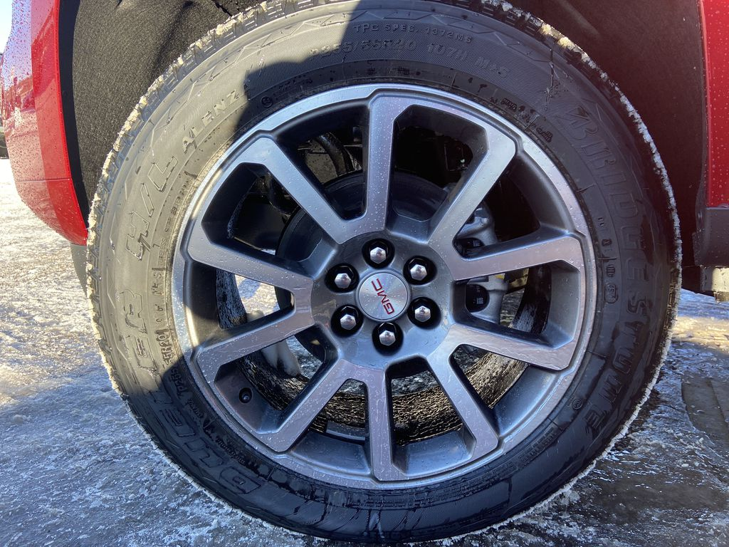 Red[Cayenne Red Tintcoat] 2021 GMC Canyon Denali Left Front Rim and Tire Photo in Calgary AB
