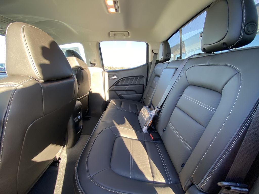 Red[Cayenne Red Tintcoat] 2021 GMC Canyon Denali Left Side Rear Seat  Photo in Calgary AB