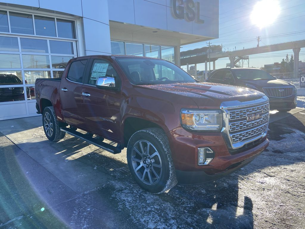 Red[Cayenne Red Tintcoat] 2021 GMC Canyon Denali Right Front Corner Photo in Calgary AB