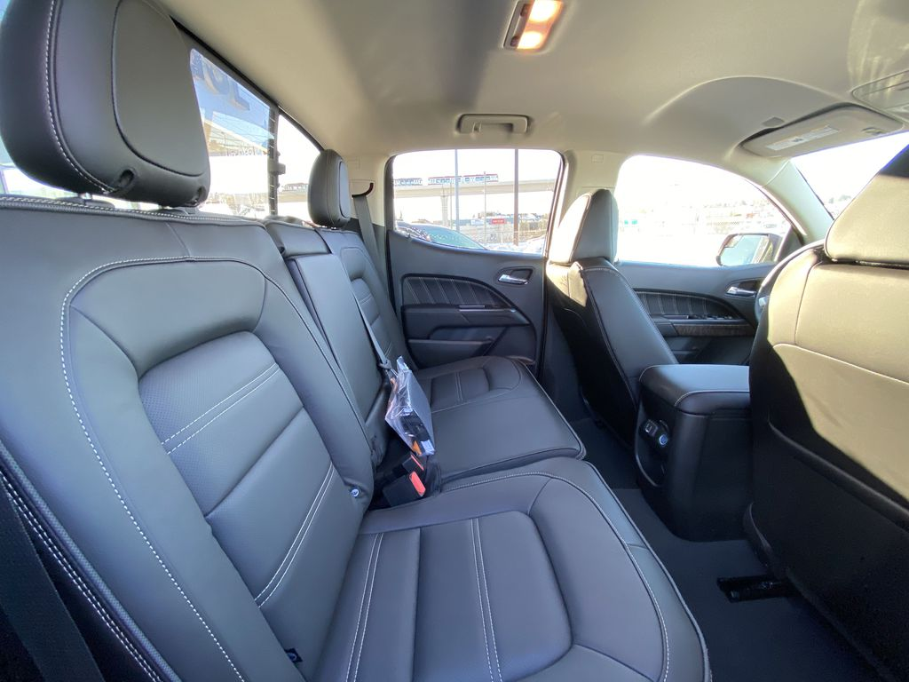 Red[Cayenne Red Tintcoat] 2021 GMC Canyon Denali Right Side Rear Seat  Photo in Calgary AB