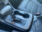 Red[Cayenne Red Tintcoat] 2021 GMC Canyon Denali Center Console Photo in Calgary AB