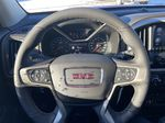 Red[Cayenne Red Tintcoat] 2021 GMC Canyon Denali Steering Wheel and Dash Photo in Calgary AB