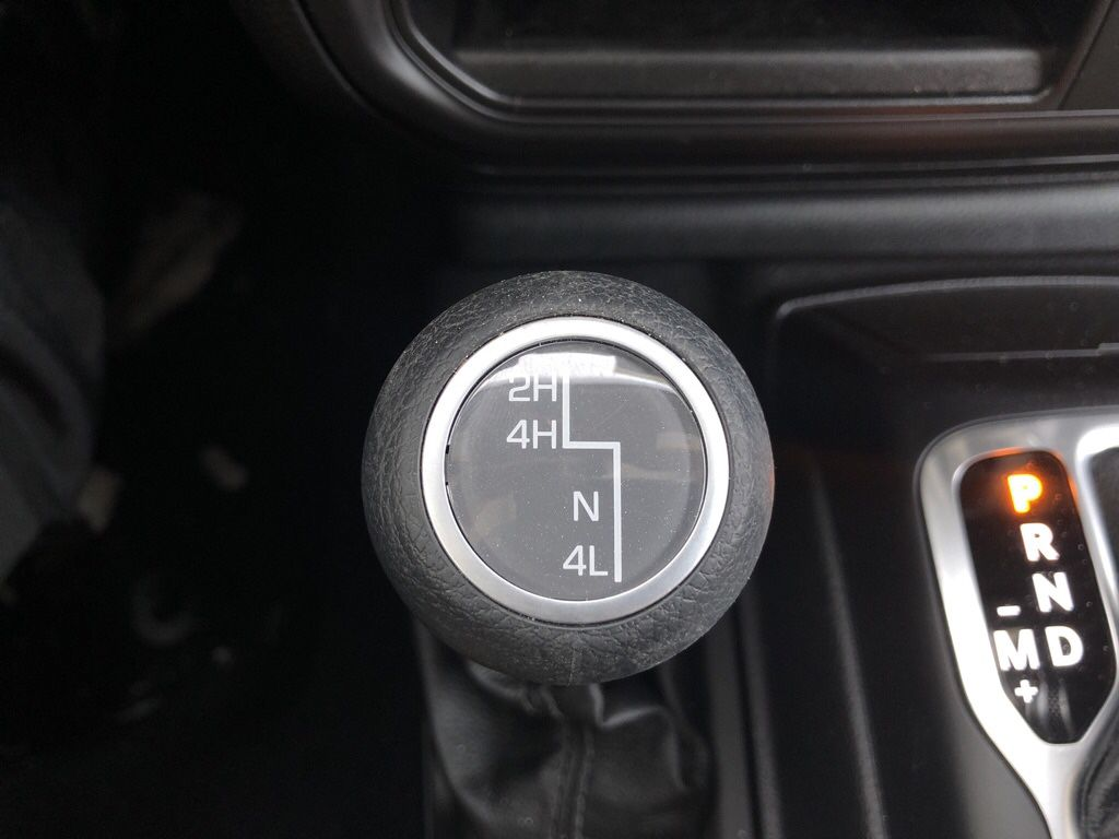 White 2018 Jeep Wrangler Unlimited Radio Controls Closeup Photo in Fort Macleod AB