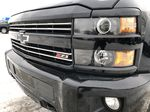 Black[Black] 2016 Chevrolet Silverado 2500HD Left Front Head Light / Bumper and Grill in Edmonton AB