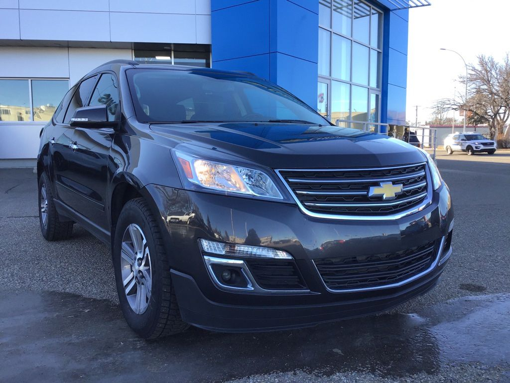 Grey 2017 Chevrolet Traverse Left Front Head Light / Bumper and Grill in Brooks AB