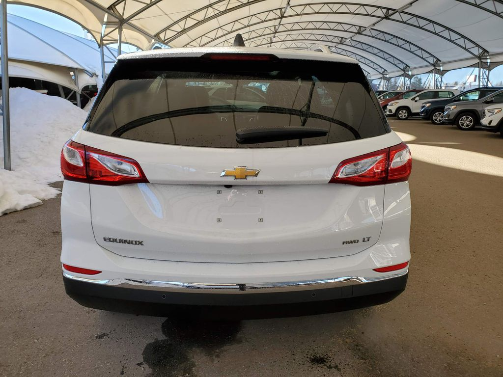 White 2021 Chevrolet Equinox Strng Wheel/Dash Photo: Frm Rear in Airdrie AB
