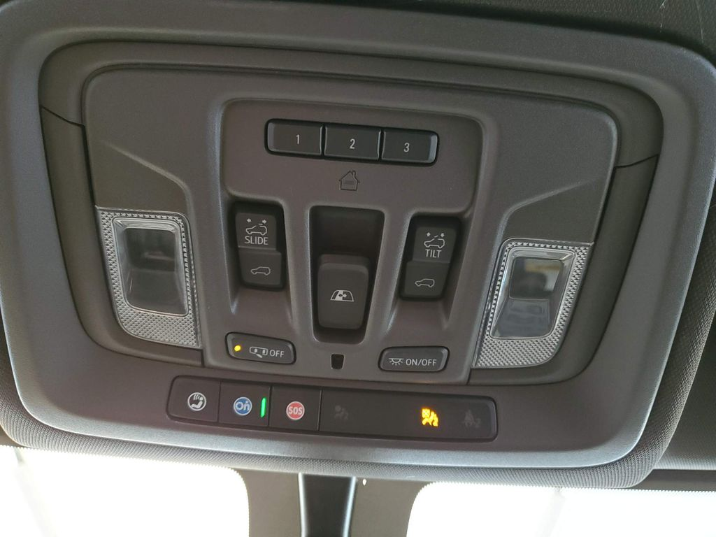 Black 2021 GMC Sierra 2500HD Steering Wheel and Dash Photo in Airdrie AB