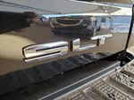 Black 2021 GMC Sierra 2500HD Passenger Front Door Controls Photo in Airdrie AB