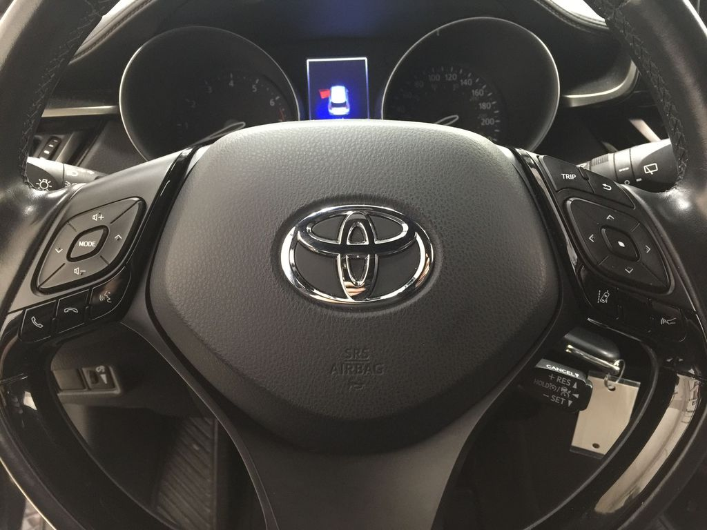 Black[Black Sand Pearl] 2018 Toyota C-HR XLE Steering Wheel and Dash Photo in Sherwood Park AB