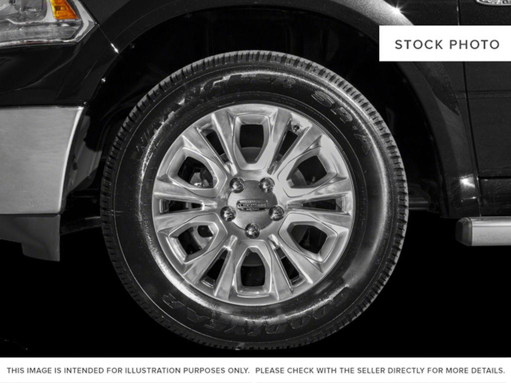 Green[Black Forest Green Pearl] 2016 Ram 1500 Left Front Rim and Tire Photo in Fort Macleod AB