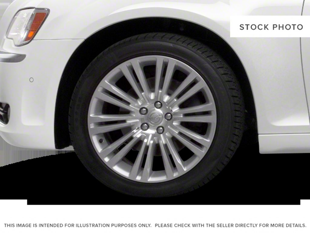Silver[Billet Metallic] 2013 Chrysler 300 Left Front Rim and Tire Photo in Fort Macleod AB